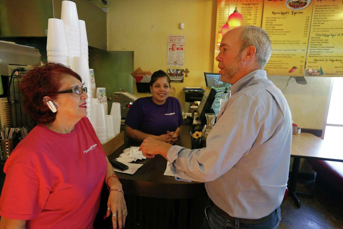 Pepe's Tacos N' Salsa manager Lulu Torres (from left) and cashier Rhonda Lopez talk with Joseph Kopser, Monday July 10, 2017 at the restaurant. Kopser is the leading Democrat vying to challenge U.S. Rep. Lamar Smith in 2018.