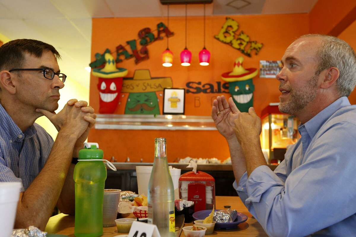Supporter Michael Brough (left) talks with Joseph Kopser, Monday July 10, 2017 at Pepe's Tacos N' Salsa. Kopser is the leading Democrat vying to challenge U.S. Rep. Lamar Smith in 2018.