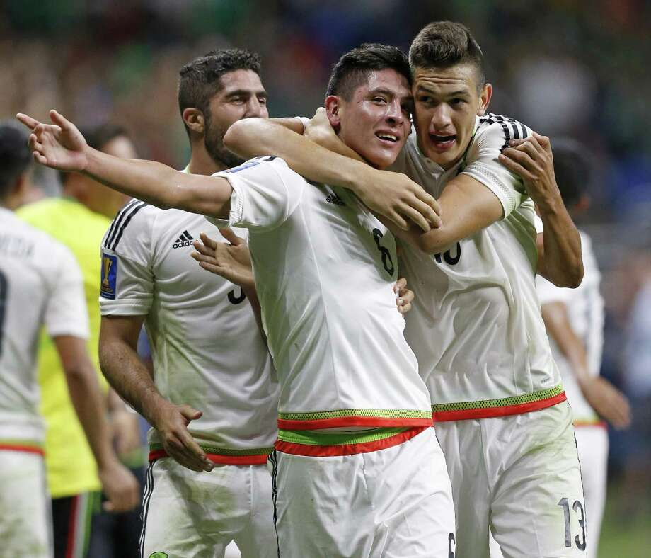 MexicoÕs Edson Alvarez (left) celebrates with teammate Cesar Montes after scoring a goal against Curacao during their CONCACAF Gold Cup soccer match held Sunday July 16, 2017 at the Alamodome. Mexico won 2-0. Photo: Edward A. Ornelas, Staff / San Antonio Express-News / © 2017 San Antonio Express-News