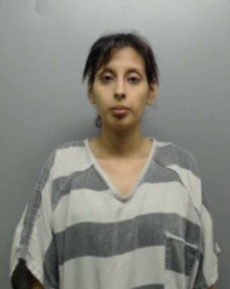 Vanessa Garza, 34, was served with warrants that charged her with 35 counts of credit or debit card abuse and felony theft. Photo: Webb County Sheriff's Office