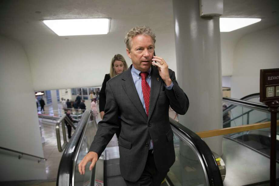 Sen. Rand Paul, R-Ky., a key opponent of the Republican health care bill, arrives for weekly policy meetings on Capitol Hill in Washington, Tuesday, July 11, 2017. With at least a dozen Republicans opposing or challenging parts of the GOP health care bill, Senate Majority Leader Mitch McConnell, R-Ky., said he will unveil their revised health care bill Thursday and begin voting on it next week. (AP Photo/J. Scott Applewhite) Photo: J. Scott Applewhite, STF / Copyright 2017 The Associated Press. All rights reserved.