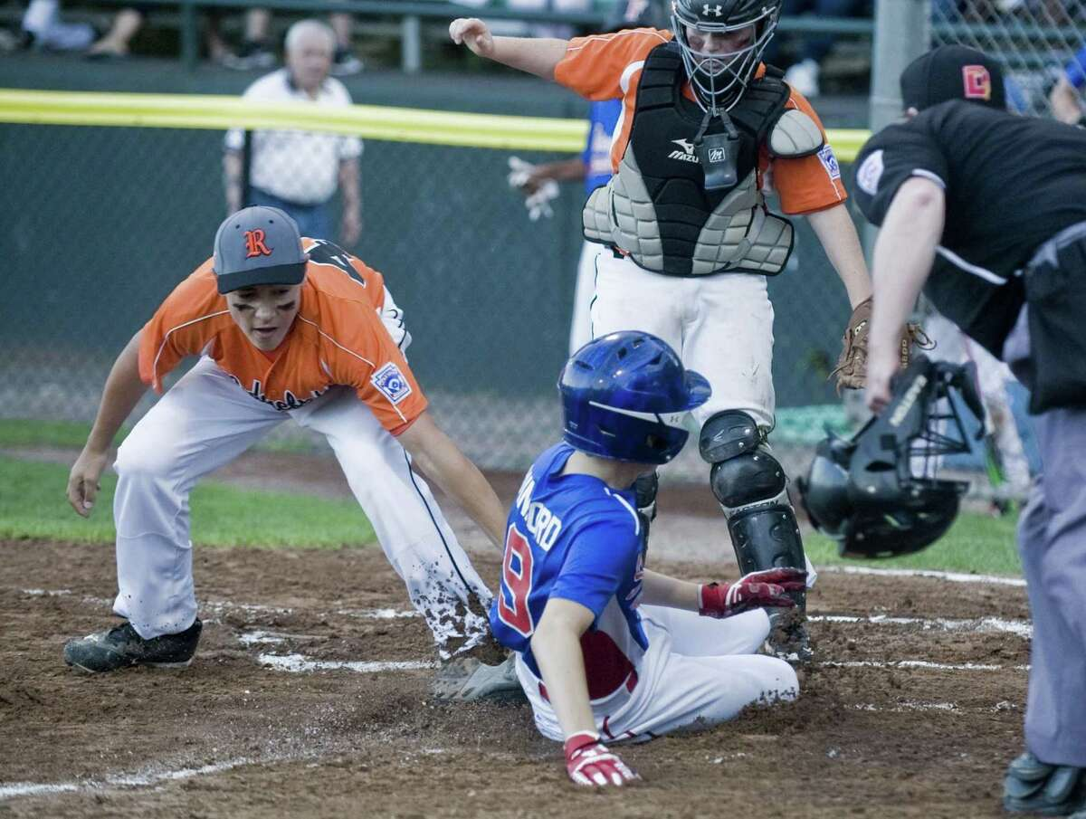 Ridgefield first baseman Matthew Bucciero tries to get Stamford North's Dylan Winford at the plate in the District 1 Little League Championship played at Springdale Little League Field in Stamford. Saturday, July 15, 2017