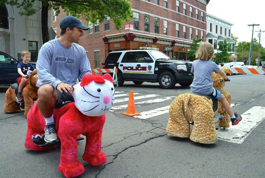 Brian Karl of New Canaan takes a ride on a Zippy Pet at the annual Village Fair & Sidewalk Sale, Saturday, July 15, 2017, in New Canaan, Conn. Photo: Jarret Liotta / For Hearst Connecticut Media / New Canaan News Freelance