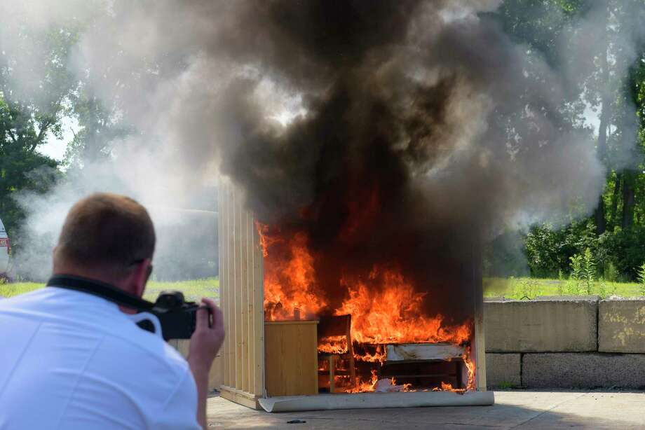 A mock college dorm room burns during a fire demonstration by the New York State Homeland Security Services at the Colonie Fire Training Center on Monday, July 17, 2017, in Latham, N.Y.  The mock college dorm room was used to alert parents and students getting ready for college to think about fire safety as they are buying items for the room and to take fire safety seriously once at college.     (Paul Buckowski / Times Union) Photo: PAUL BUCKOWSKI, Albany Times Union / 20041059A