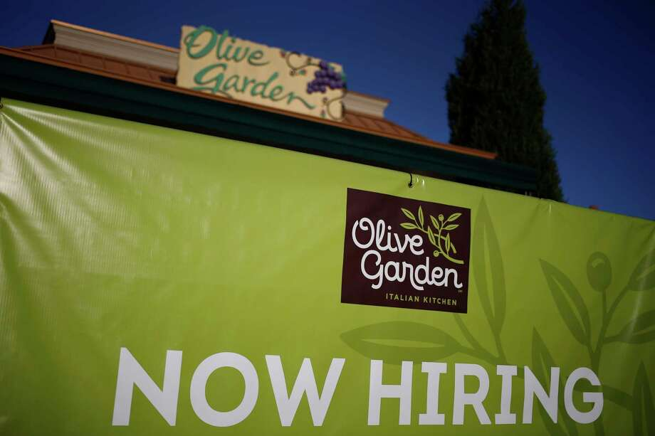 a now hiring sign outside an olive garden location in louisville kentucky - Olive Garden Louisville