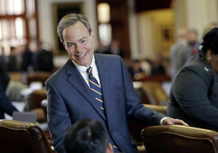 Texas Speaker of the House Joe Straus, R-San Antonio, talks with fellow lawmakers on the House floor at the Texas Capitol in April.
