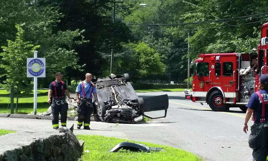 A serious motor-vehicle accident closed Fillow Street in Norwalk, Conn. on Monday, July 17, 2017. Norwalk police say the accident, one vehicle overturned onto its roof near the Oak Hills golf course, involved injuries. Photo: Alex Von Kleydorff / Hearst Connecticut Media / Norwalk Hour