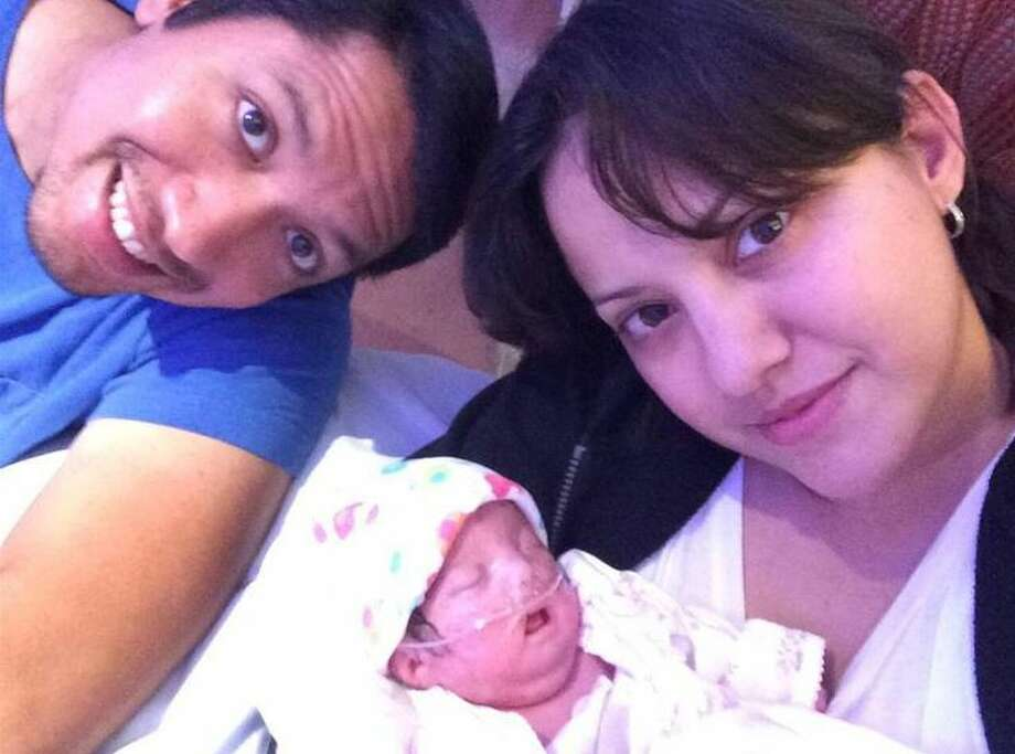 Agustin and Samantha Gonzalez-Muralidharan are pictured with their late daughter, Alejandra Maria. Photo: Courtesy