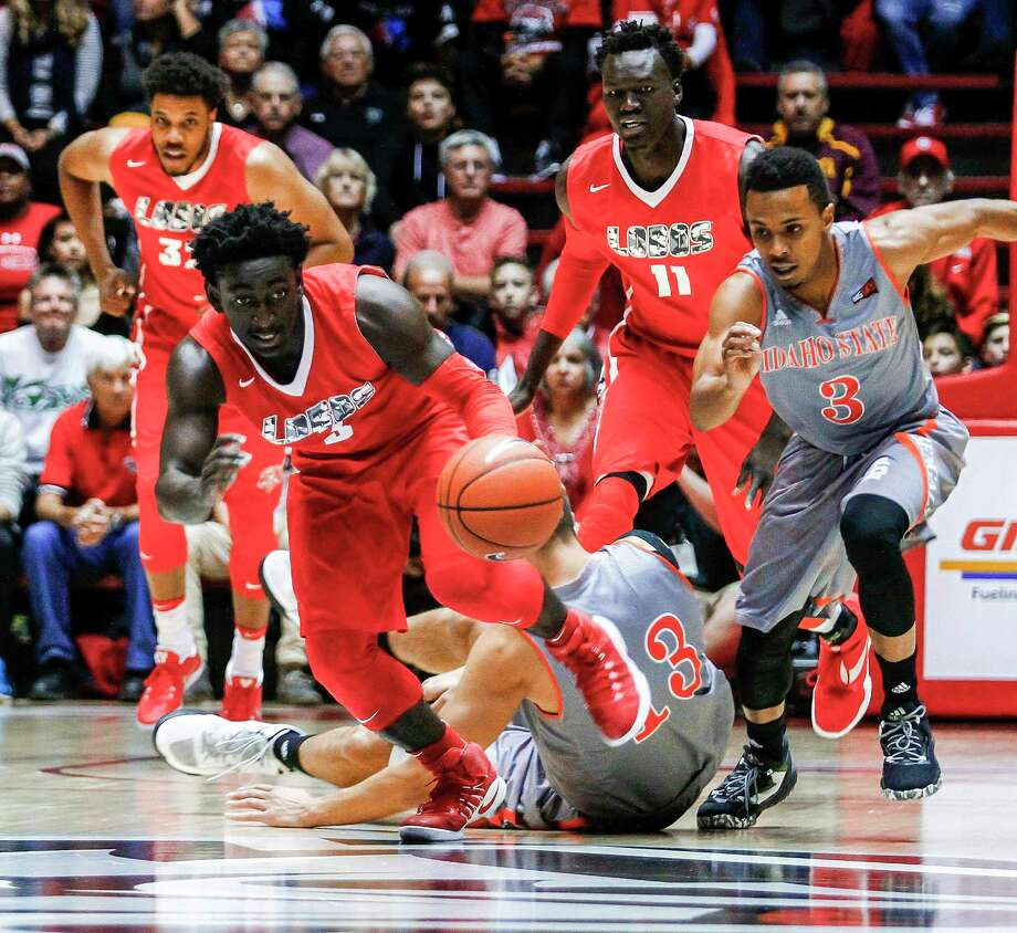 New Mexico's Jordan Hunter (3) grabs up a loose ball from the Idaho defense during the first half of an NCAA college basketball game in Albuquerque, N.M., Friday, Nov. 11, 2016. (AP Photo/Juan Antonio Labreche) Photo: Juan Antonio Labreche, FRE / FR171079 AP