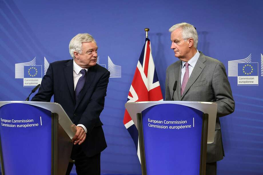 Britain's Brexit minister, David Davis (left), meets with EU negotiator David Davis in Brussels. Photo: Dario Pignatelli, Bloomberg