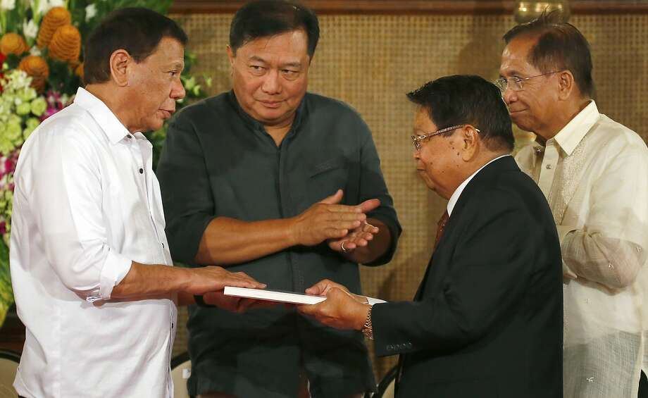 Philippine President Rodrigo Duterte (left) receives a draft of the proposed autonomy bill from Ghazali Jaafar, the vice chairman of the Moro Islamic Liberation Front, in Manila. Photo: Bullit Marquez, Associated Press