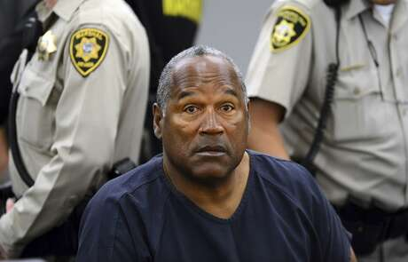 FILE - In this May 14, 2013 pool file photo, O.J. Simpson sits during a break on the second day of an evidentiary hearing in Clark County District Court in Las Vegas. Simpson, the former football star, TV pitchman and now Nevada prison inmate, will have a lot going for him when he appears before state parole board members Thursday, July 20, 2017 seeking his release after more than eight years for an ill-fated bid to retrieve sports memorabilia. (AP Photo/Ethan Miller, Pool, File) Photo: Ethan Miller, Associated Press