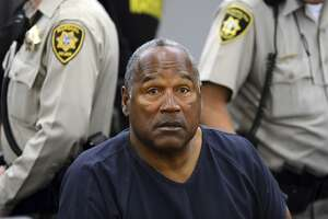 FILE - In this May 14, 2013 pool file photo, O.J. Simpson sits during a break on the second day of an evidentiary hearing in Clark County District Court in Las Vegas. Simpson, the former football star, TV pitchman and now Nevada prison inmate, will have a lot going for him when he appears before state parole board members Thursday, July 20, 2017 seeking his release after more than eight years for an ill-fated bid to retrieve sports memorabilia. (AP Photo/Ethan Miller, Pool, File)