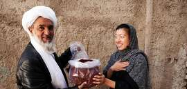 Afghan saffron farmer and Kimberly Jung