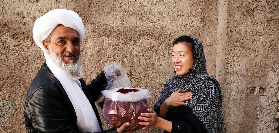 Afghan saffron farmer and Kimberly Jung. Photo: Rumi Spice, With Permission To The Chronicle