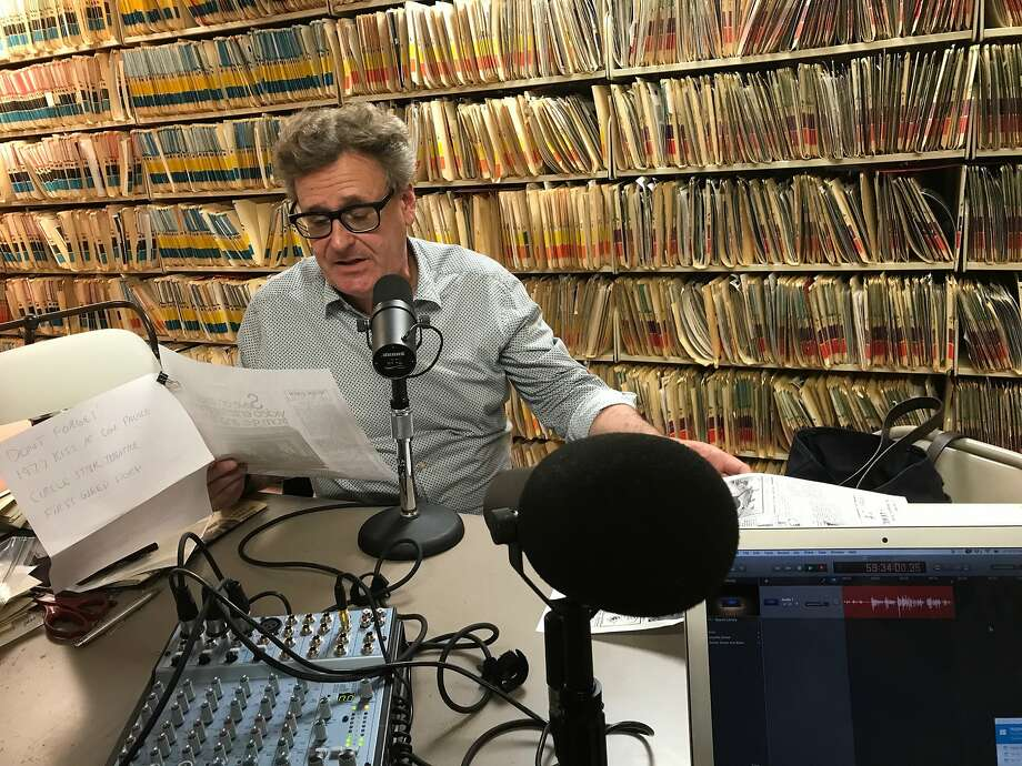Proops reads his 1980s mention in a Herb Caen column during a podcast recording at The San Francisco Chronicle. Photo: Peter Hartlaub