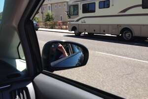 A camper parked on El Camino Real in Palo Alto, CA.