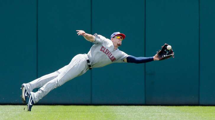 DETROIT, MI - JULY 1:  Center fielder Bradley Zimmer #4 of the Cleveland Indians lays out to catch a fly ball hit by Mikie Mahtook of the Detroit Tigers in the first game of a doubleheader during the second inning at Comerica Park on July 1, 2017 in Detroit, Michigan. (Photo by Duane Burleson/Getty Images)