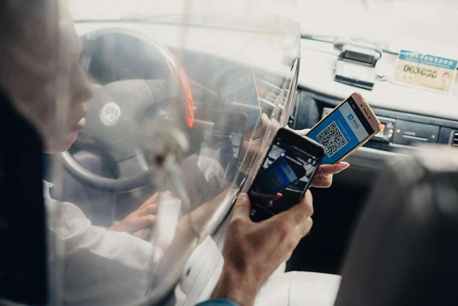 Scanning QR codes with smartphones is the way most people pay in Shanghai — including when they use a taxi driver. Photo: YUYANG LIU, NYT
