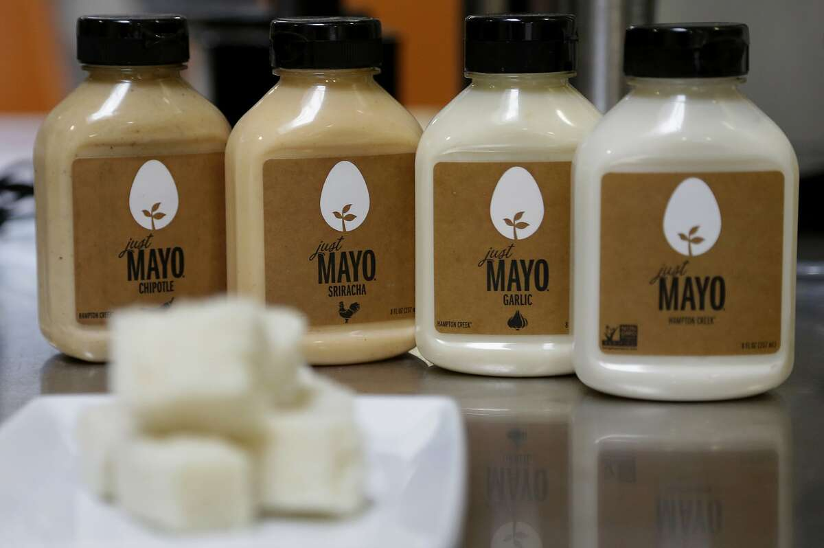 FILE - This Feb. 4, 2015, file photo, shows Hampton Creek Foods bottles of Just Mayo flavors at their office in San Francisco. Hellmann�s mayonnaise maker Unilever sued the maker of Just Mayo, a vegan spread, saying that mayonnaise is defined as having eggs under federal regulations. That lawsuit was dropped. Later, however, the maker of Just Mayo worked out an agreement with the Food and Drug Administration to keep its name, so long as it made some changes to its label to make clear the product does not contain eggs. (AP Photo/Jeff Chiu, File)