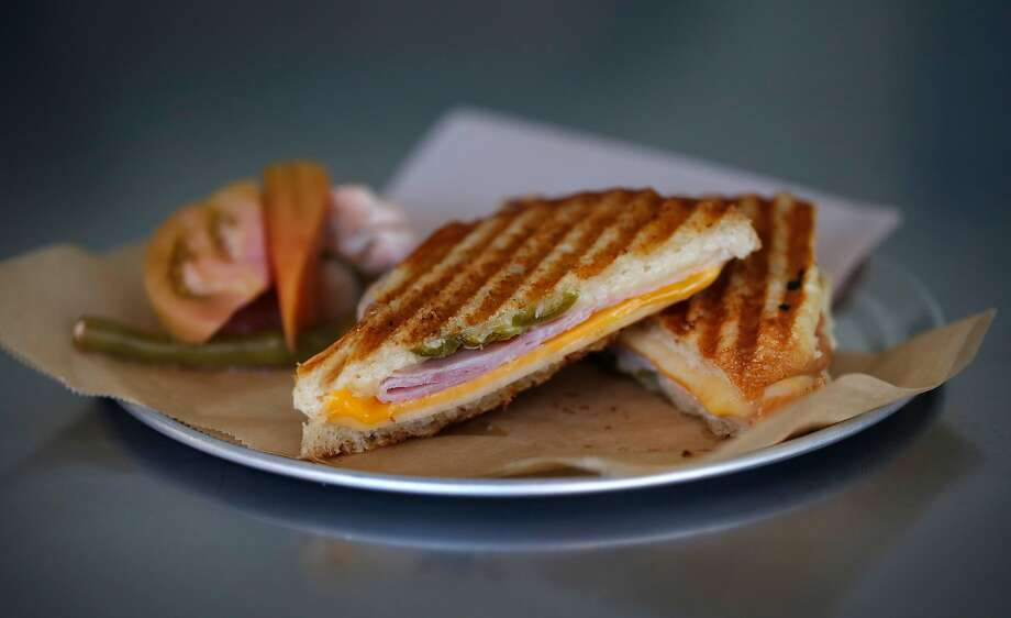 A ham, jack and cheddar grilled-cheese sandwich topped with pickled jalapeños from the menu at Fieldwork Brewing Co.'s beer garden in San Mateo. Photo: Leah Millis, The Chronicle