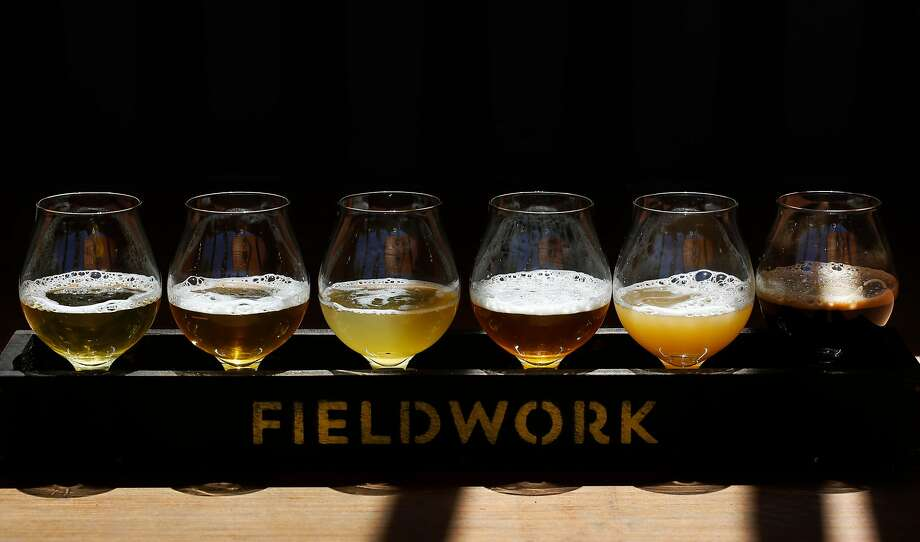 A flight of beer, from left, Old Love, Rancher, Gosaic, Treasure Hands, Overripe!, and Salted Coconut pictured at Fieldwork Brewing Company July 14, 2017 in San Mateo, Calif. Photo: Leah Millis, The Chronicle