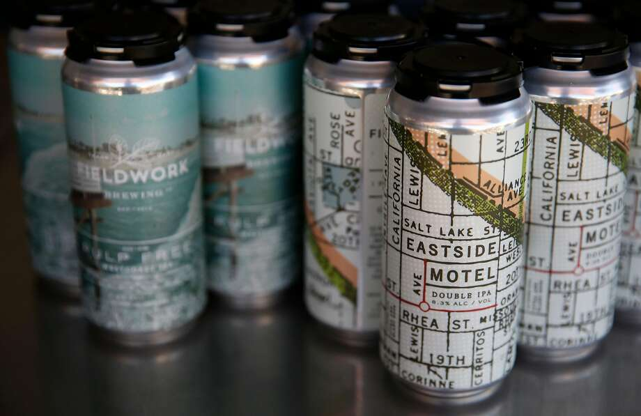 Two four packs of canned beer that Fieldwork Brewing Company offers customers pictured July 14, 2017 in San Mateo, Calif. Photo: Leah Millis / Hearst