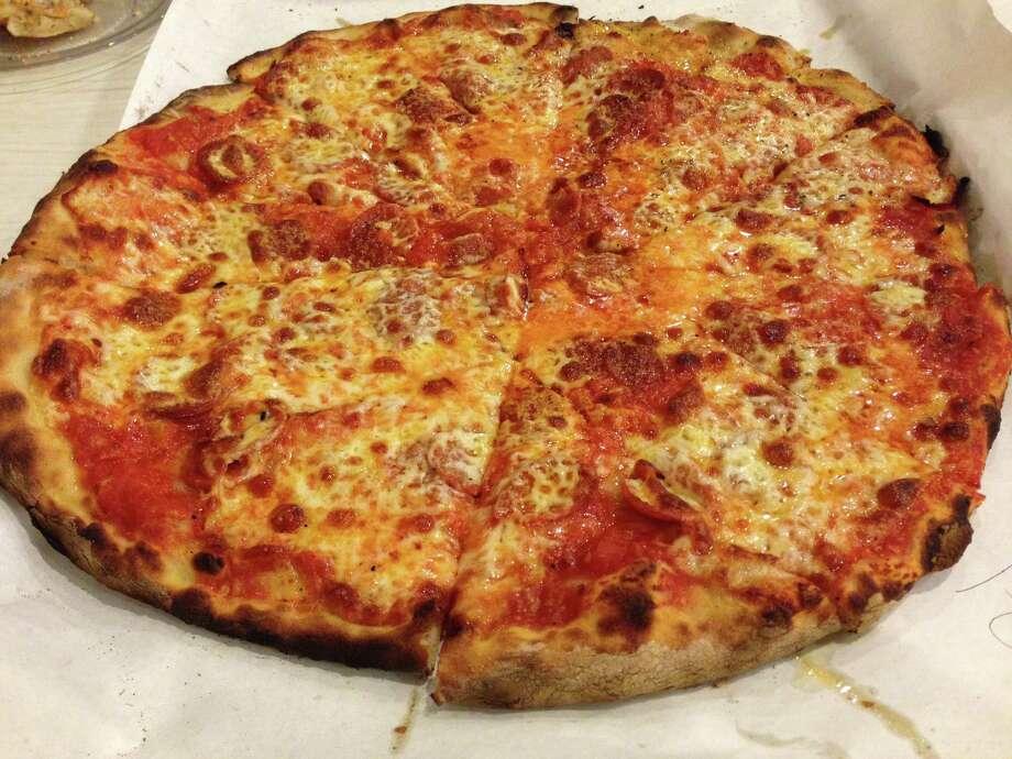 A tomato and mozzarella pizza from Frank Pepe Pizzeria Napoletana in New Haven, CT. Photo: Greg Morago