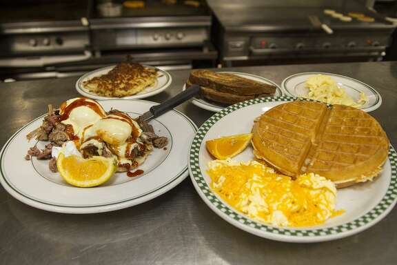 Magnolia Pancake Haus won the Readers' Choice 2017 award for Best Breakfast. Shown are its Southern bennie (left), waffle and eggs dishes.