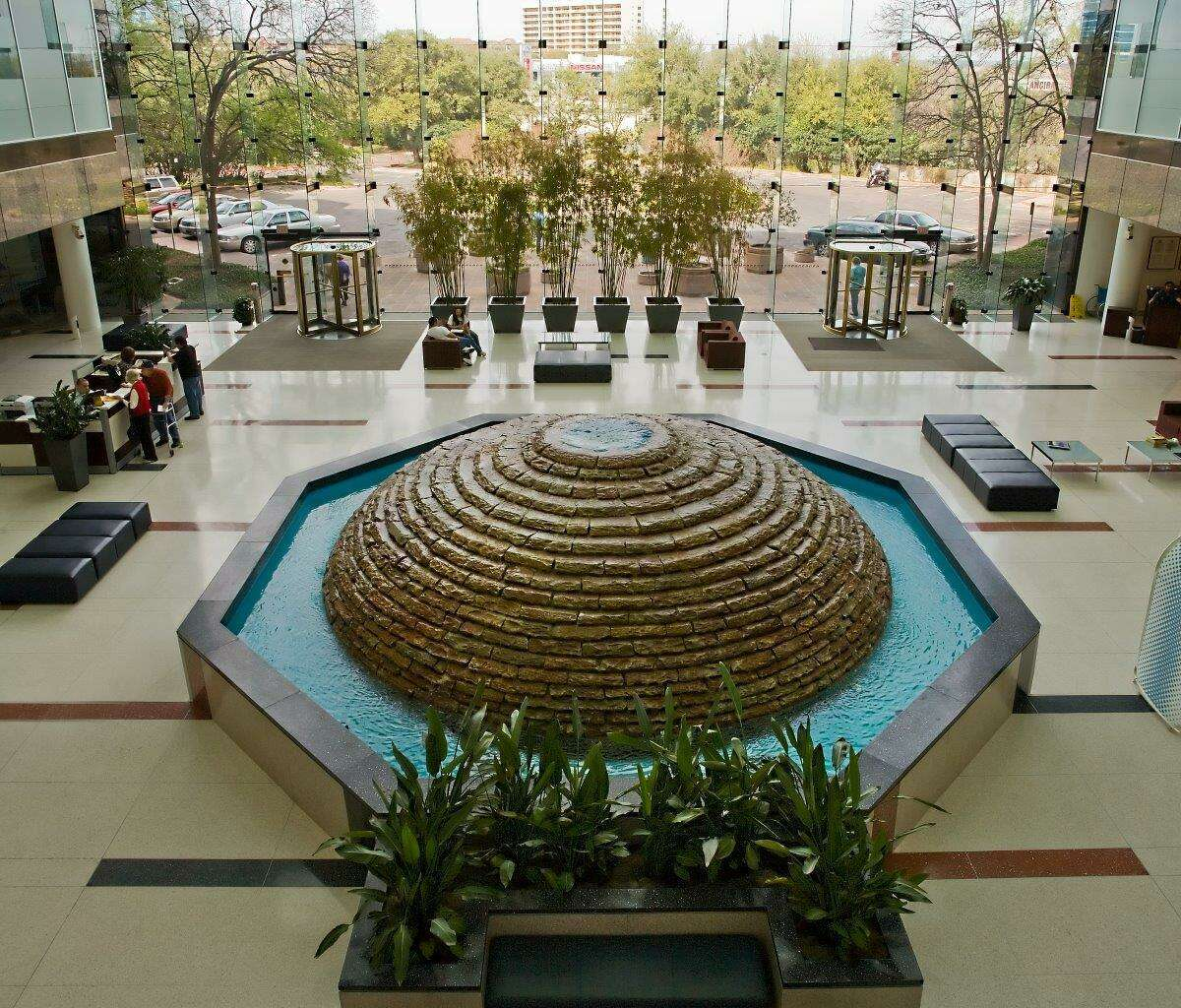 USAA Federal Savings Bank has confidentially settled a lawsuit over its overdraft charges. Pictured is the lobby of the bank's branch at USAA's San Antonio campus.