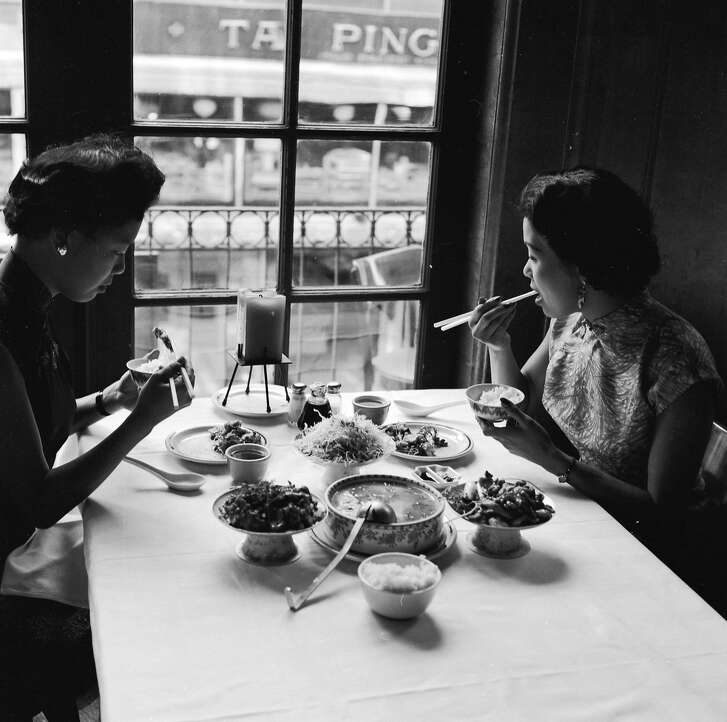 circa 1955:  Two women sample the bird's nest soup and other delicacies on offer at Johnny Kan's famous Chinese restaurant in Chinatown, San Francisco.  (Photo by Orlando /Three Lions/Getty Images)