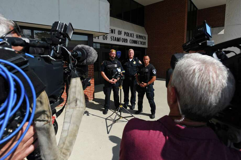 From left, Officer Michael Montanaro, Sgt, Charles White and Officer Damien Rosa speak during a news conference at Stamford Police headquarters on Monday.Rosa and Montanaro rescued a 7-year-old boy who fell off the fishing pier at Cummings Park on Sunday evening. Photo: Michael Cummo / Hearst Connecticut Media / Stamford Advocate