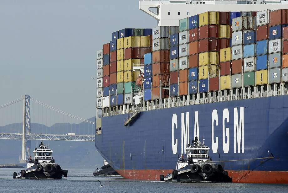 A container ship is guided by tugboats as it arrives at the Port of Oakland to be unloaded Thursday, Feb. 12, 2015, in Oakland, Calif. Photo: Ben Margot, Associated Press
