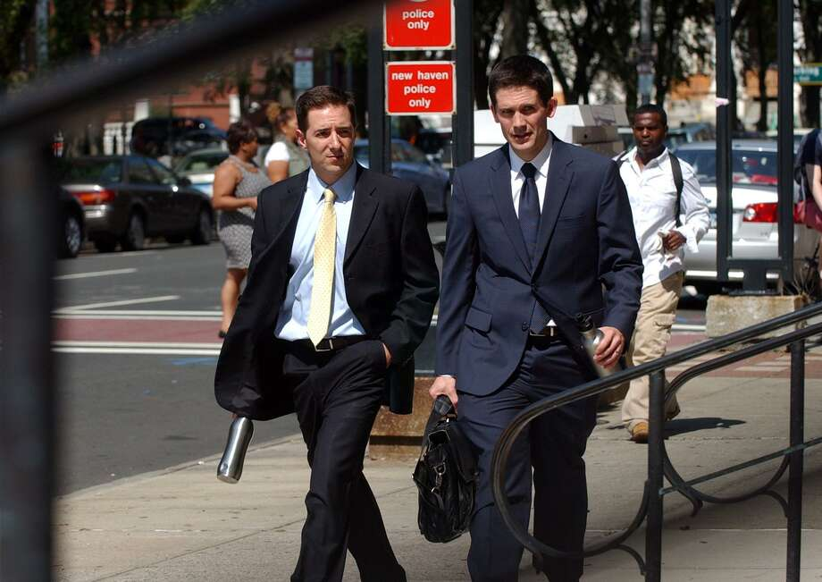 Prosecutors Chris Mattei, left, and Liam Brennan, enter the Federal Courthouse after a break during day three in the John Rowland trial in downtown New Haveno on Sept. 5, 2014. Photo: Christian Abraham / Christian Abraham / Connecticut Post
