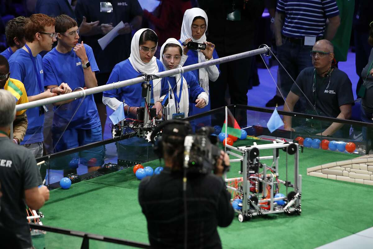 The Afghanistan girls team competes in the First Global Robotics Challenge, Monday, July 17, 2017, in Washington. The challenge is an international robotics event with teams from over 100 countries. (AP Photo/Jacquelyn Martin)