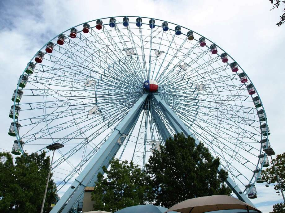 The Texas State Fair's 21-story Ferris wheel provides a bird's-eye view of the fairgrounds and downtown Dallas. Photo: Express-News File Photo