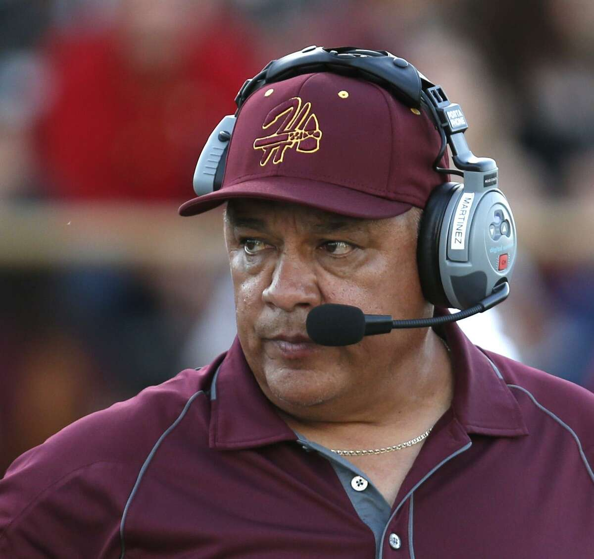 Harlandale head coach Isaac Martinez watches his team last fall. He has been named Harlandale ISD athletic director, replacing Rudy de los Santos who had 21 years in the position.