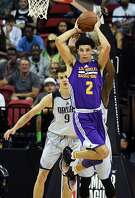 LAS VEGAS, NV - JULY 16:  Lonzo Ball #2 of the Los Angeles Lakers looks to pass in front of Nicolas Brussino #9 of the Dallas Mavericks during a semifinal game of the 2017 Summer League at the Thomas & Mack Center on July 16, 2017 in Las Vegas, Nevada. Los Angeles won 108-98. NOTE TO USER: User expressly acknowledges and agrees that, by downloading and or using this photograph, User is consenting to the terms and conditions of the Getty Images License Agreement.  (Photo by Ethan Miller/Getty Images)