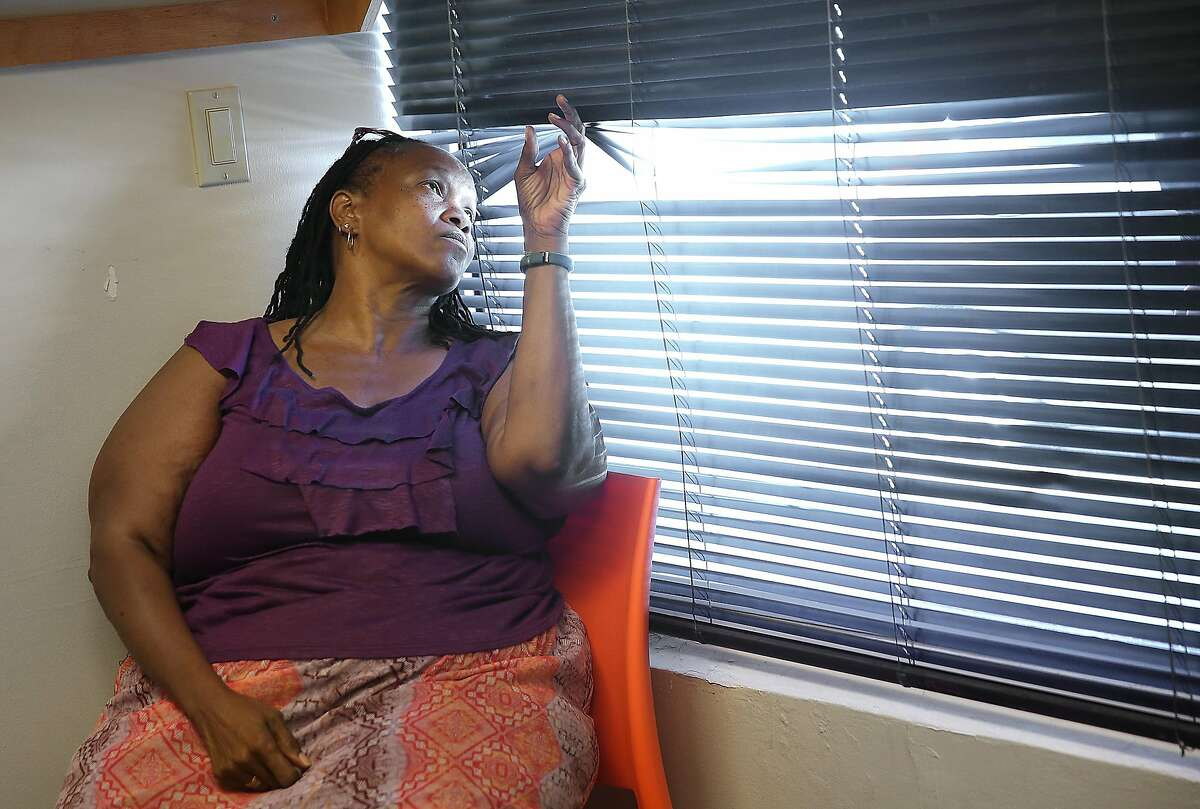 Case manager Cathy Morris looks outside the window at the latest Navigation Center, a one-stop comprehensive shelter aimed at quickly housing the homeless, on Monday, July 17, 2017 in San Francisco, Calif.