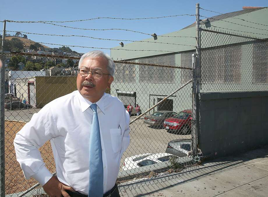 Mayor Ed Lee (right) takes an outside street tour of the latest Navigation Center (green building), a one-stop comprehensive shelter aimed at quickly housing the homeless, on Monday, July 17, 2017 in San Francisco, Calif. Photo: Liz Hafalia, The Chronicle