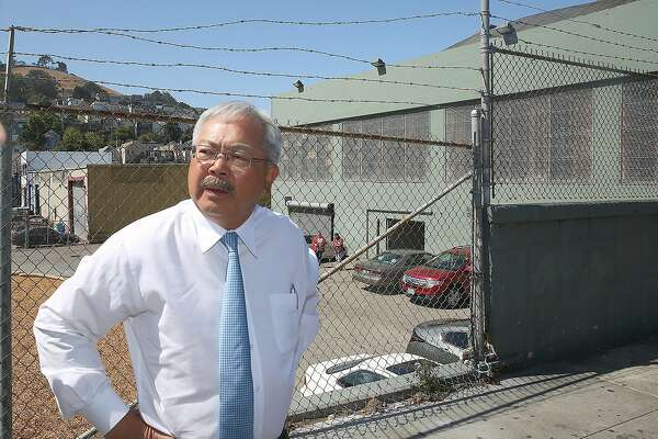Mayor Ed Lee (right) takes an outside street tour of the latest Navigation Center (green building), a one-stop comprehensive shelter aimed at quickly housing the homeless, on Monday, July 17, 2017 in San Francisco, Calif.