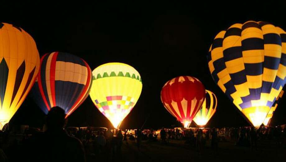 The appeal of a balloon glow will pack the staging area both nights during the RE/MAX Skylight Balloon Fest in October. Photo: Courtesy Photo /Courtesy Photo