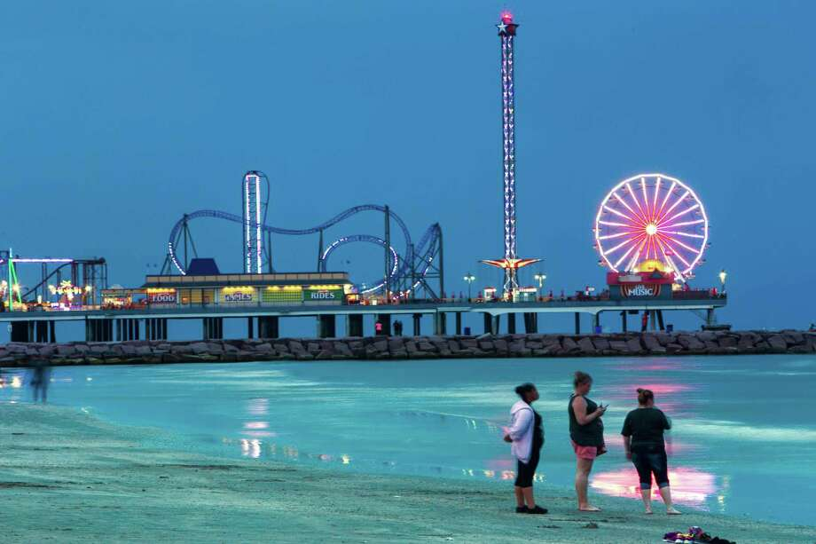 The lights of the Pleasure Pier light up the night sky over the water in Galveston. Photo: Brett Coomer /Houston Chronicle / © 2016 Houston Chronicle