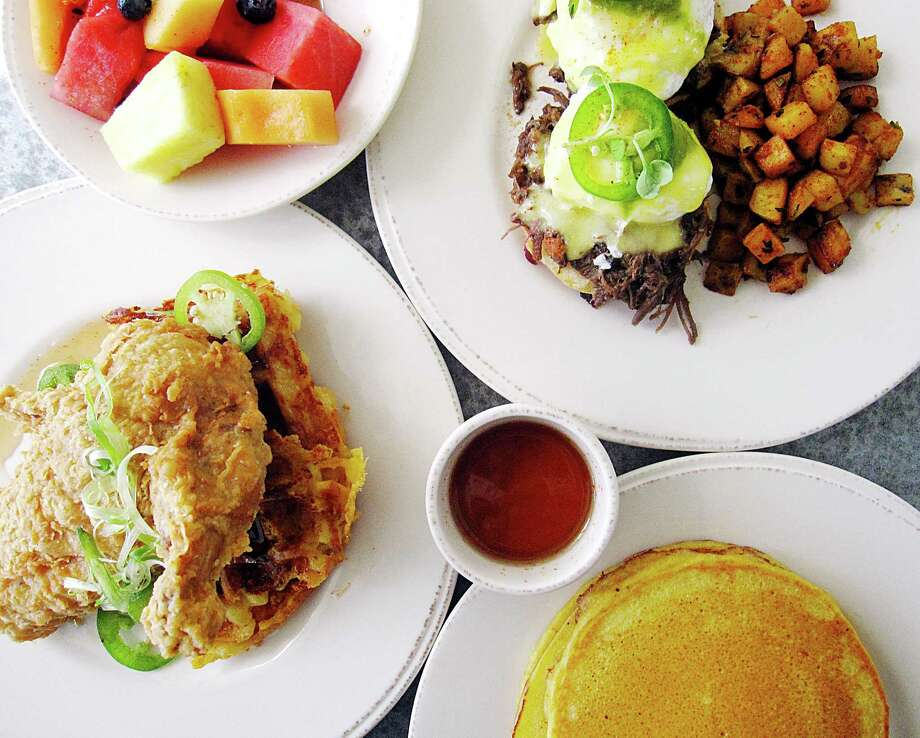 """Dishes from the Sunday brunch menu at Peggy's on the Green in Boerne. Clockwise from left: Fried chicken with mac and cheese """"waffles,"""" fruit, short rib Benedict and cornmeal Johnny cakes. Photo: Mike Sutter / San Antonio Express-News"""