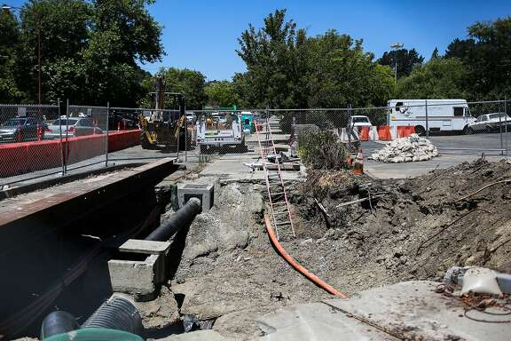 A sinkhole at the intersection of Center Avenue and Rheem Street is barricaded off in Moraga, Calif., on Monday, July 17, 2017.