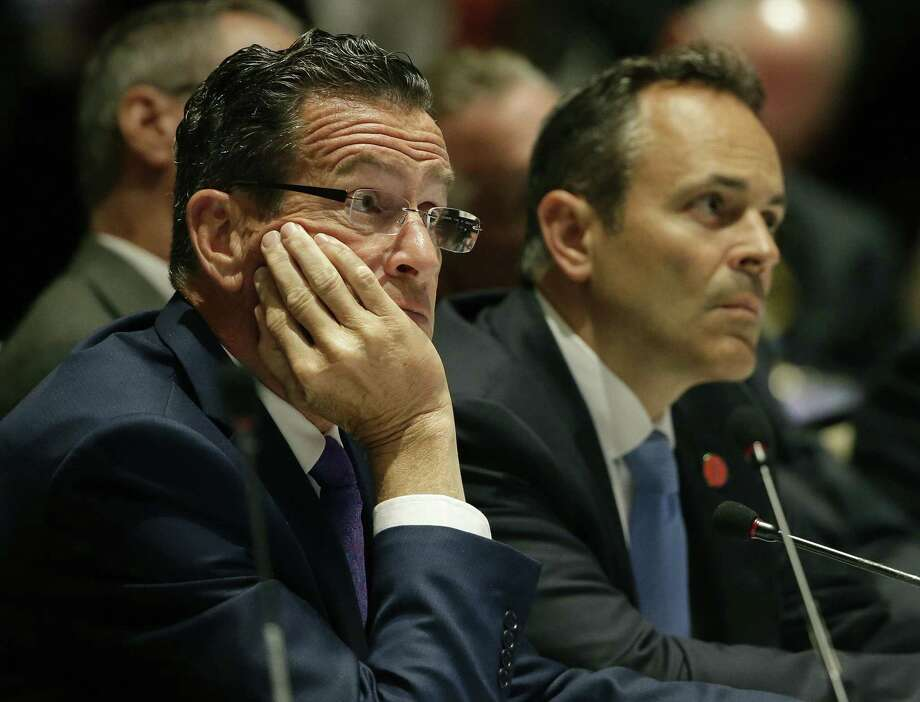 """Connecticut Democratic Gov. Dannel Malloy, left, and Kentucky Republican Gov. Matthew Bevin listens to a presentation during a session called """"Curbing The Opioid Epidemic"""" on the first day of the National Governor's Association meeting in Providence, R.I. on Thursday. Photo: Stephan Savoia / Associated Press / Copyright 2017 The Associated Press. All rights reserved."""