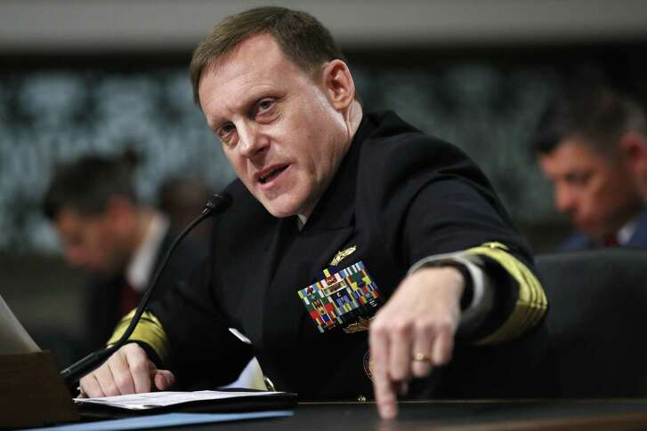 FILE - In this May 9, 2017, file photo, U.S. Cyber Command and the National Security Agency Director Adm. Mike Rogers testifies on Capitol Hill in Washington. U.S. officials say the Trump administration, after months of delay, is finalizing plans to revamp the nation's military command for defensive and offensive cyber-operations. The plan would eventually split it from the intelligence-focused National Security Agency in hopes of intensifying America's ability to wage cyber war against the Islamic State group and other foes. (AP Photo/Jacquelyn Martin, File)