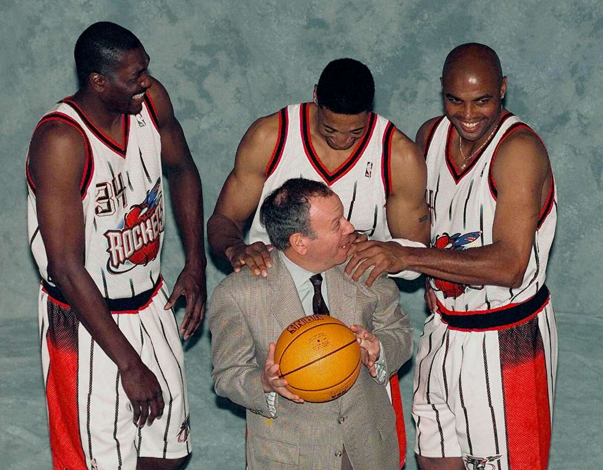 Houston Rockets', from left to right, Hakeem Olajuwon, Scottie Pippen and Charles Barkley joke with team owner Leslie Alexander, front, as they pose for a photograph during media day Tuesday, Jan. 26, 1999 in Houston. The Rockets will play an exhibition game with the San Antonio Spurs Tuesday night. (AP Photo/David J. Phillip)