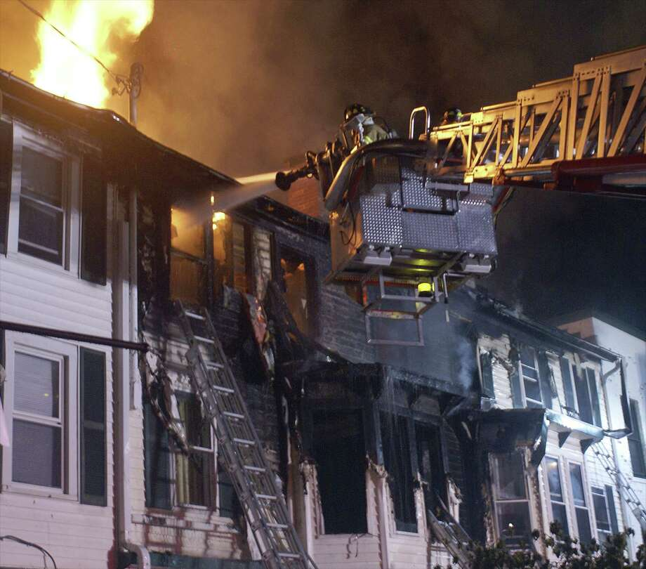The state fire marshal's office is still investigating the cause of the fire on Greenwood Avenue that started around 1 a.m. Thursday and took 100 firefighters from area towns to extinguish. Photo: Contributed Photo / Rob Fish / The News-Times Contributed