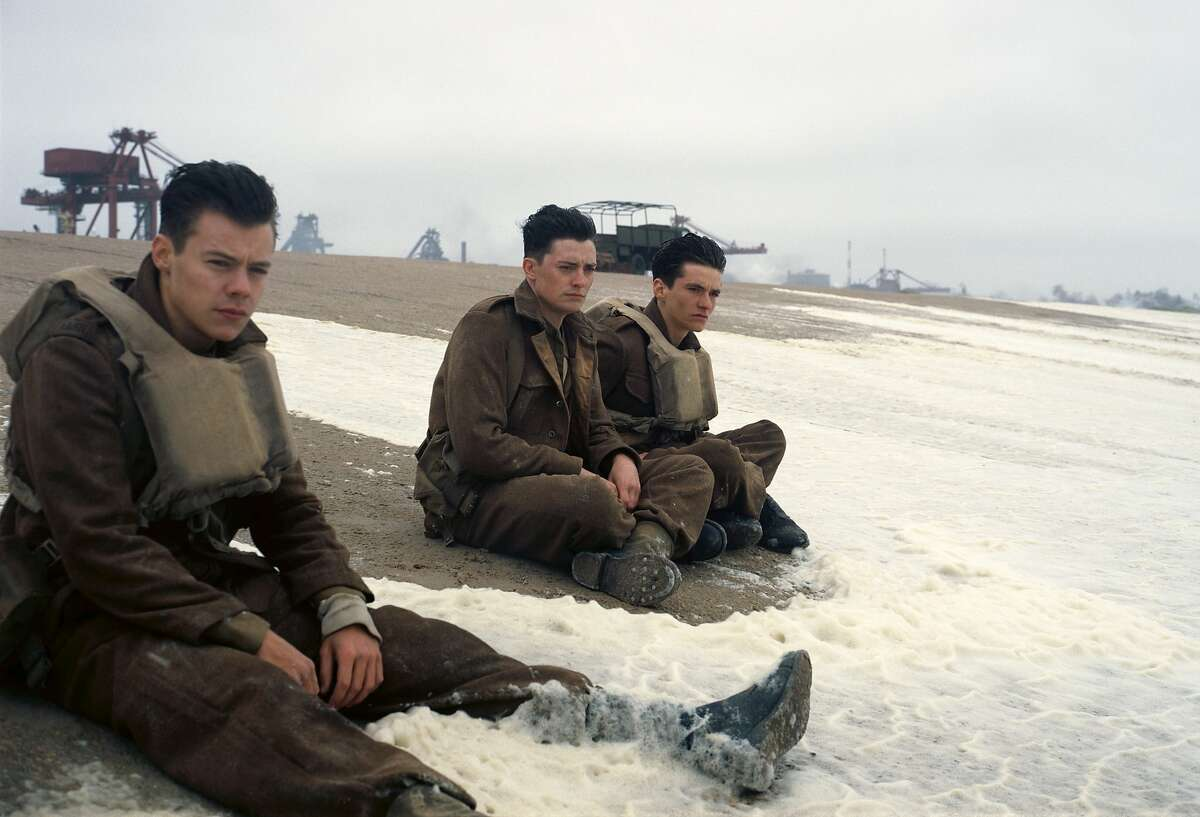 This image released by Warner Bros. Pictures shows Harry Styles, from left, Aneurin Barnard and Fionn Whitehead in a scene from